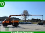 Autokran des Typs Unimog Unimog mit 110 PS und 9,80 Meter Kran in Hinterschmiding