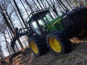 John Deere 6610 Лесной трактор