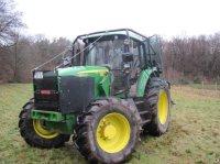 John Deere 6830 Лесной трактор