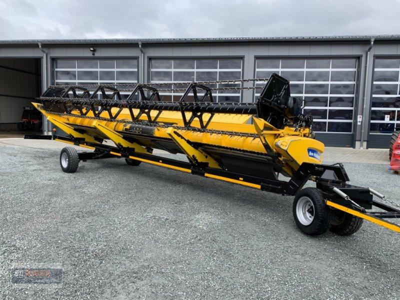 Mähdrescher des Typs New Holland Schneidwerk Varifeed 9,15m, Gebrauchtmaschine in Lichtenfels (Bild 1)