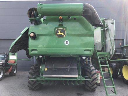 Oldtimer-Mähdrescher des Typs John Deere S670i, Neumaschine in Звенигородка (Bild 4)