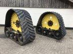 Raupentraktor des Typs John Deere Rupsen в Vriezenveen