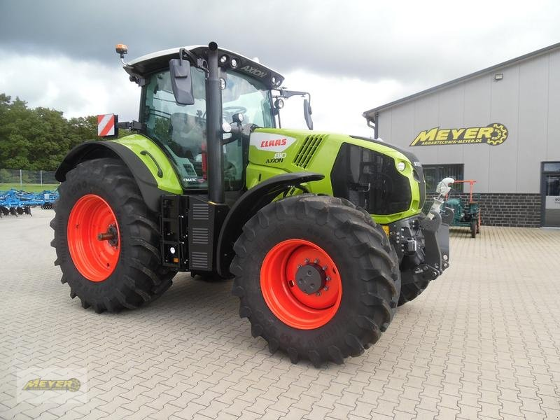 Traktor des Typs CLAAS AXION 810 CMATIC CEBIS, Neumaschine in Andervenne (Bild 1)