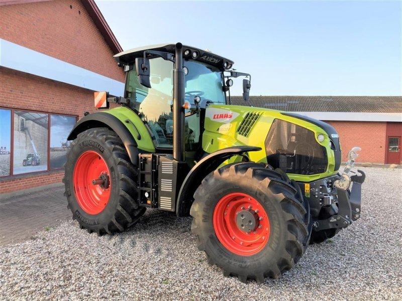 Traktor типа CLAAS AXION 830 CIS + Fokus model m. frontlift mv., Gebrauchtmaschine в Mern (Фотография 1)