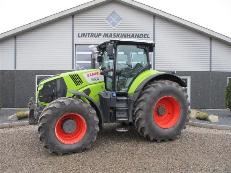Traktor des Typs CLAAS AXION 830 CMATIC Med frontlift og front PTO, Gebrauchtmaschine in Lintrup (Bild 1)