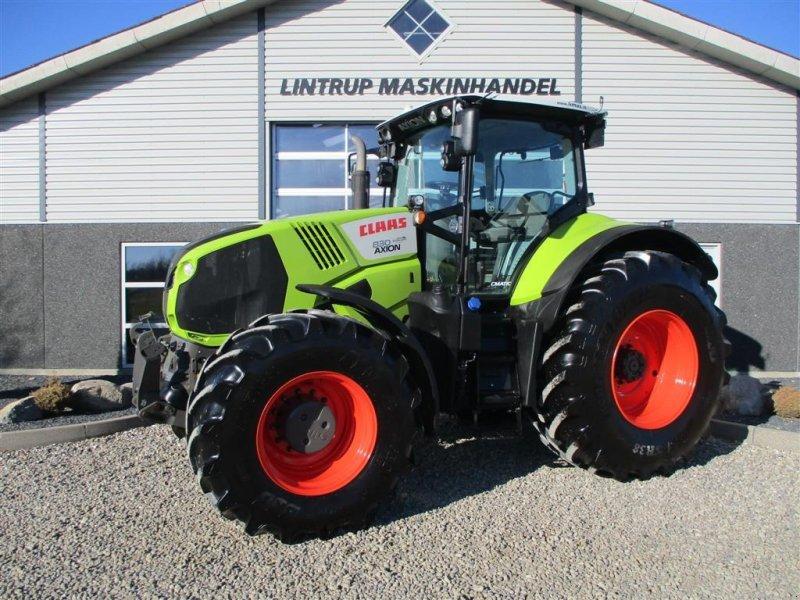 Traktor типа CLAAS AXION 830 CMATIC Med frontlift og front PTO, Gebrauchtmaschine в Lintrup (Фотография 1)