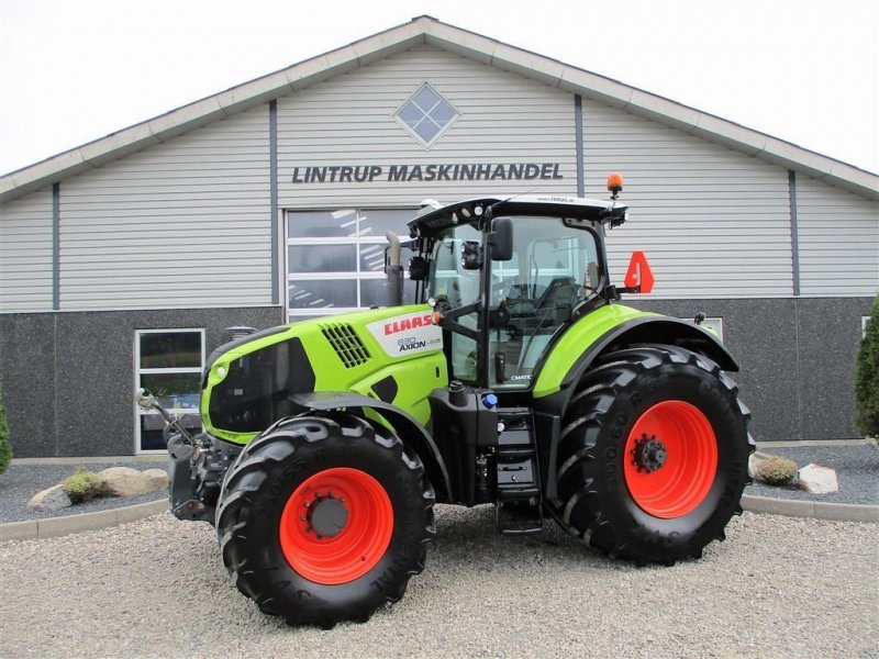 Traktor des Typs CLAAS AXION 830 CMATIC med frontlift og front-PTO, Gebrauchtmaschine in Lintrup (Bild 1)