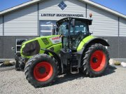 Traktor des Typs CLAAS AXION 830 CMATIC Med frontlift, Gebrauchtmaschine in Lintrup