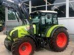 Traktor des Typs CLAAS AXOS 310 C in Beelen