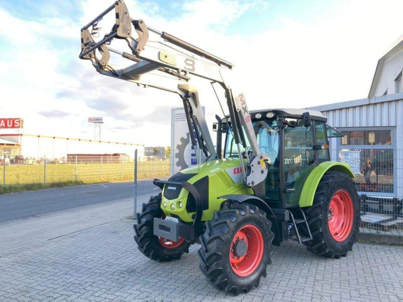 Traktor des Typs CLAAS Axos 320 CX, Gebrauchtmaschine in Stuhr (Bild 1)