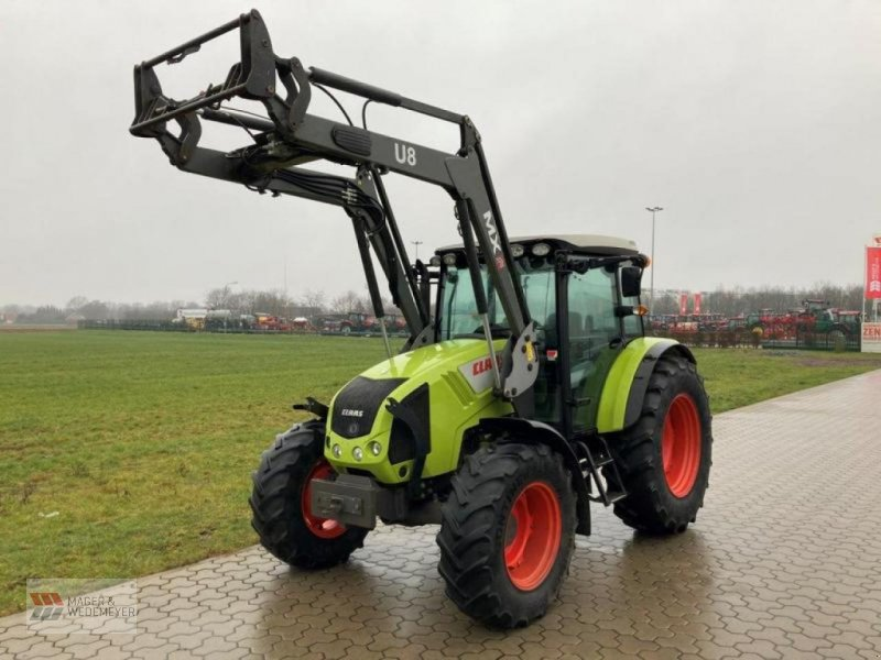 Traktor des Typs CLAAS AXOS 320, Neumaschine in Oyten (Bild 1)