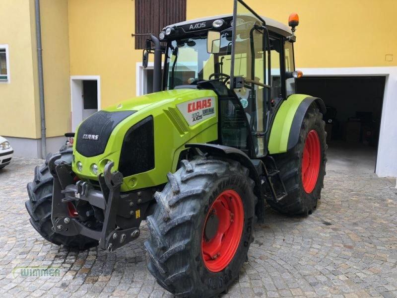 Traktor des Typs CLAAS Axos 330, Gebrauchtmaschine in Kematen (Bild 1)