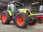 Traktor типа CLAAS Axos 340 CX в Lensahn