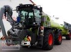 Traktor des Typs CLAAS Xerion ST mit SGT Aufbaufaß und Anhänger inkl. Bomech Verteiler, 18m AB, 32 m3 Gülle in Schierling