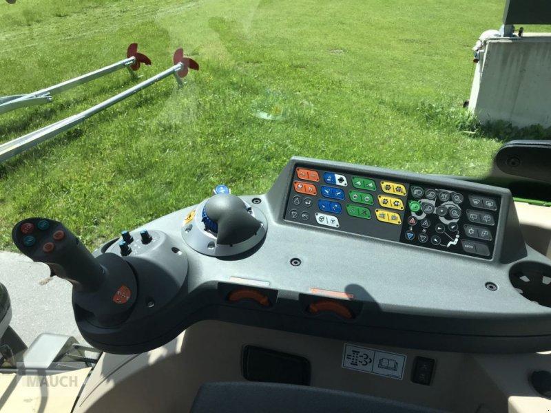 Traktor des Typs Fendt 313 Vario Power + FL Cargo 4X/75 DW, Neumaschine in Eben (Bild 11)