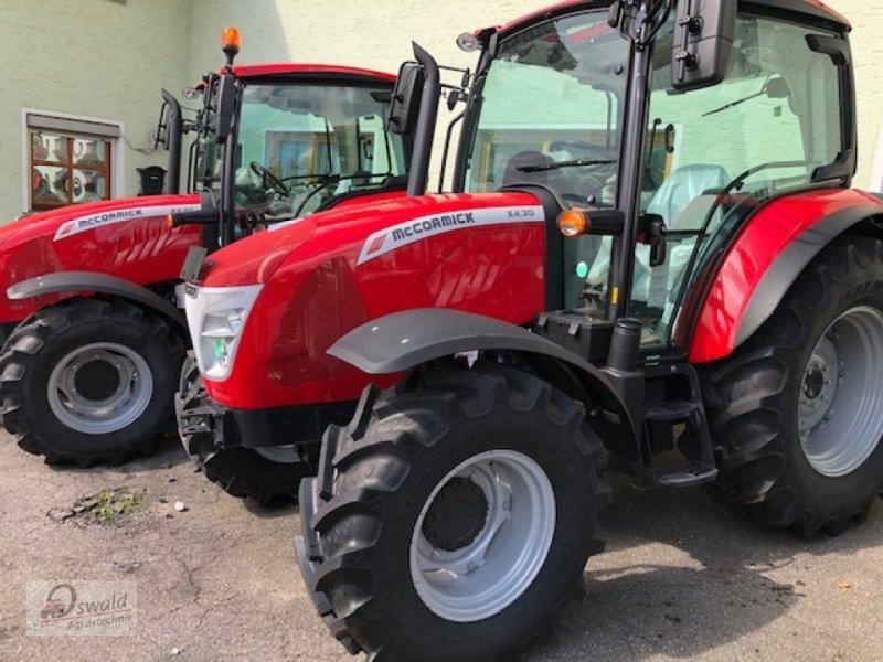 Traktor типа McCormick X 4.30, Neumaschine в Regen (Фотография 1)