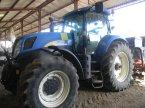 Traktor типа New Holland T7030 в ENNEZAT