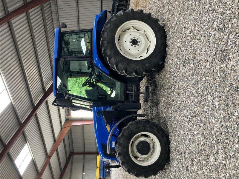 Traktor типа New Holland TL 90 A med frontlæsser KUN 2400 timer - med frontlæsser. A/C., Gebrauchtmaschine в Vejle (Фотография 1)