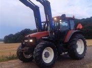 Traktor типа New Holland TM 135 med ÅLØ Q65 frontlæsser affjedret kabine og foraksel, Gebrauchtmaschine в Skive