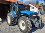 Traktor типа New Holland TM 135 в Ismaning