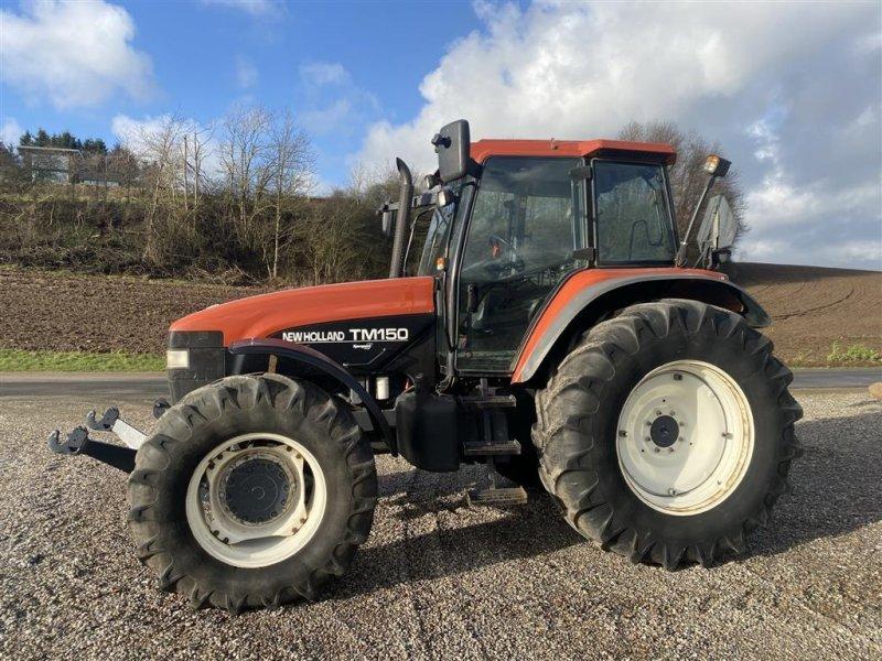 Traktor a típus New Holland TM 150 Frontlift - lavt timetal., Gebrauchtmaschine ekkor: Vejle (Kép 1)