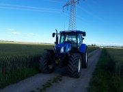 Traktor типа New Holland TS 135, Gebrauchtmaschine в Langerringen