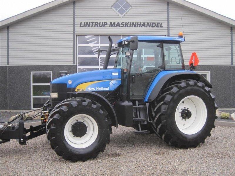 New Holland TM 190 affjedret foraksel Med frontlift og krybegear Traktor - technikboerse.com