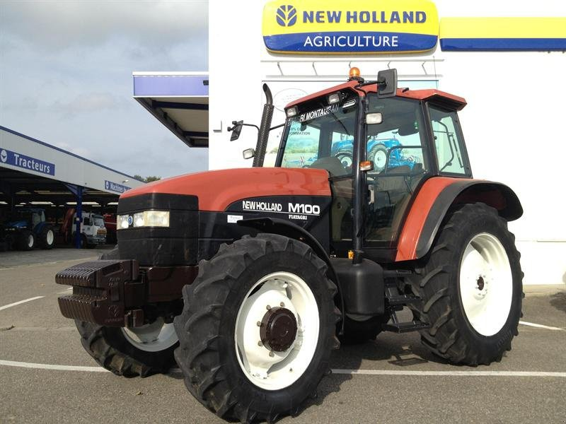 New Holland M100 Tracteur - technikboerse.com