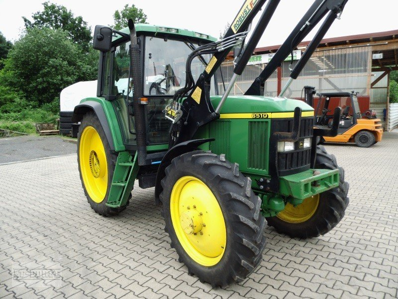 Photo John Deere 6510 A **gefederte Vorderachse**